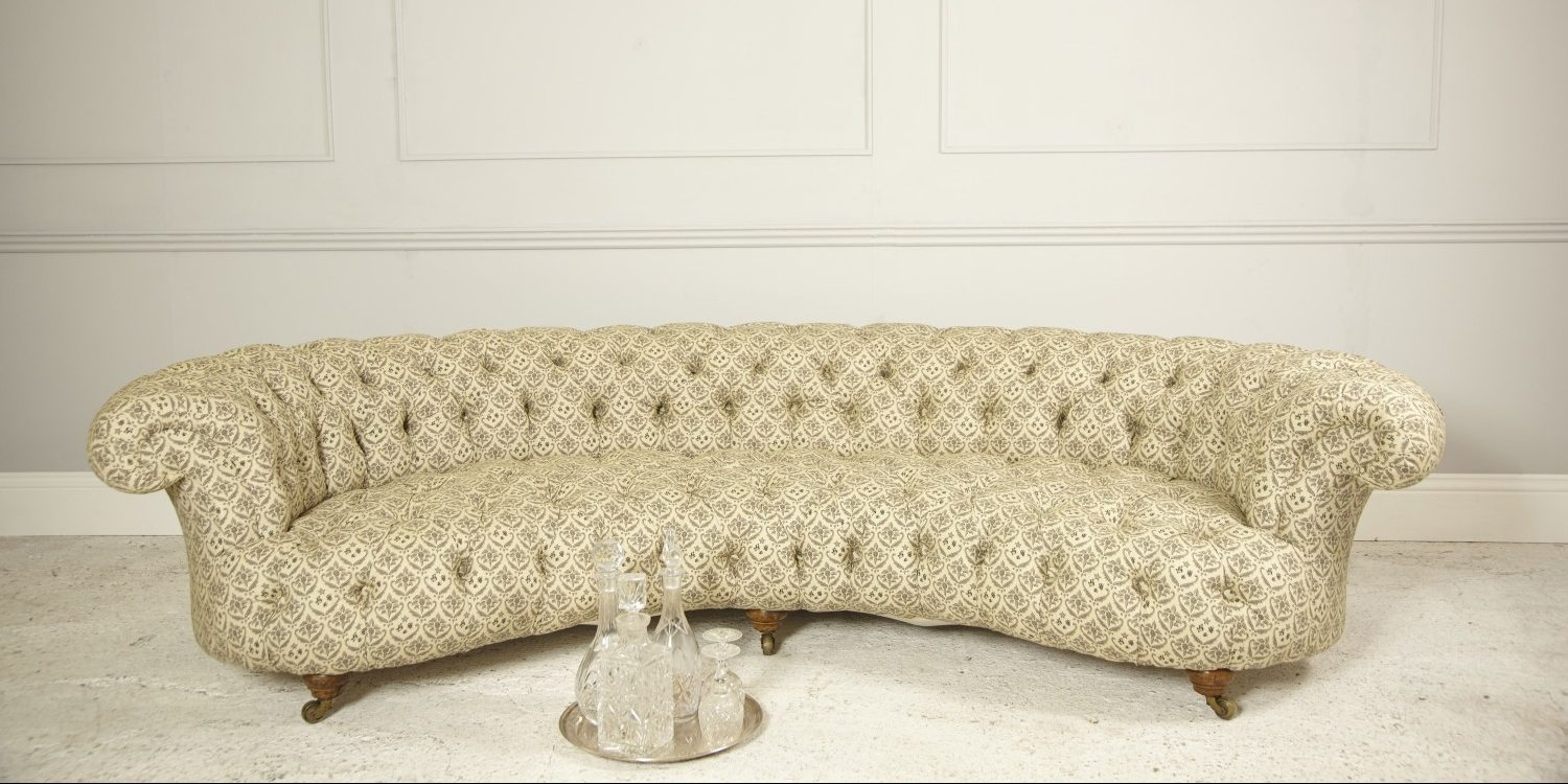 Howard and Sons crescent shaped sofa with decanter