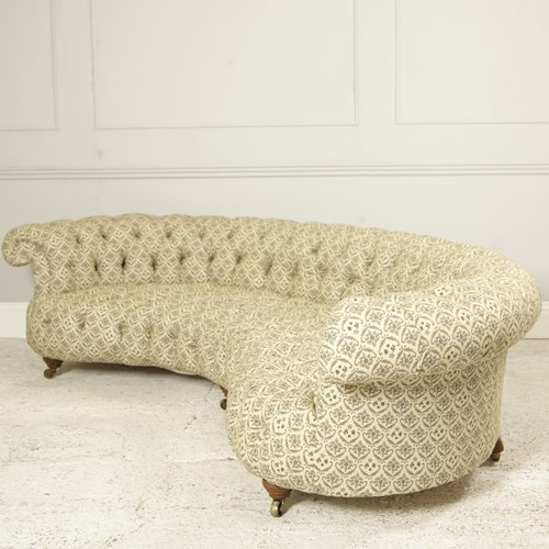 Howard and Sons crescent shaped sofa side angle