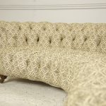 Howard and Sons crescent shaped sofa showing buttoning