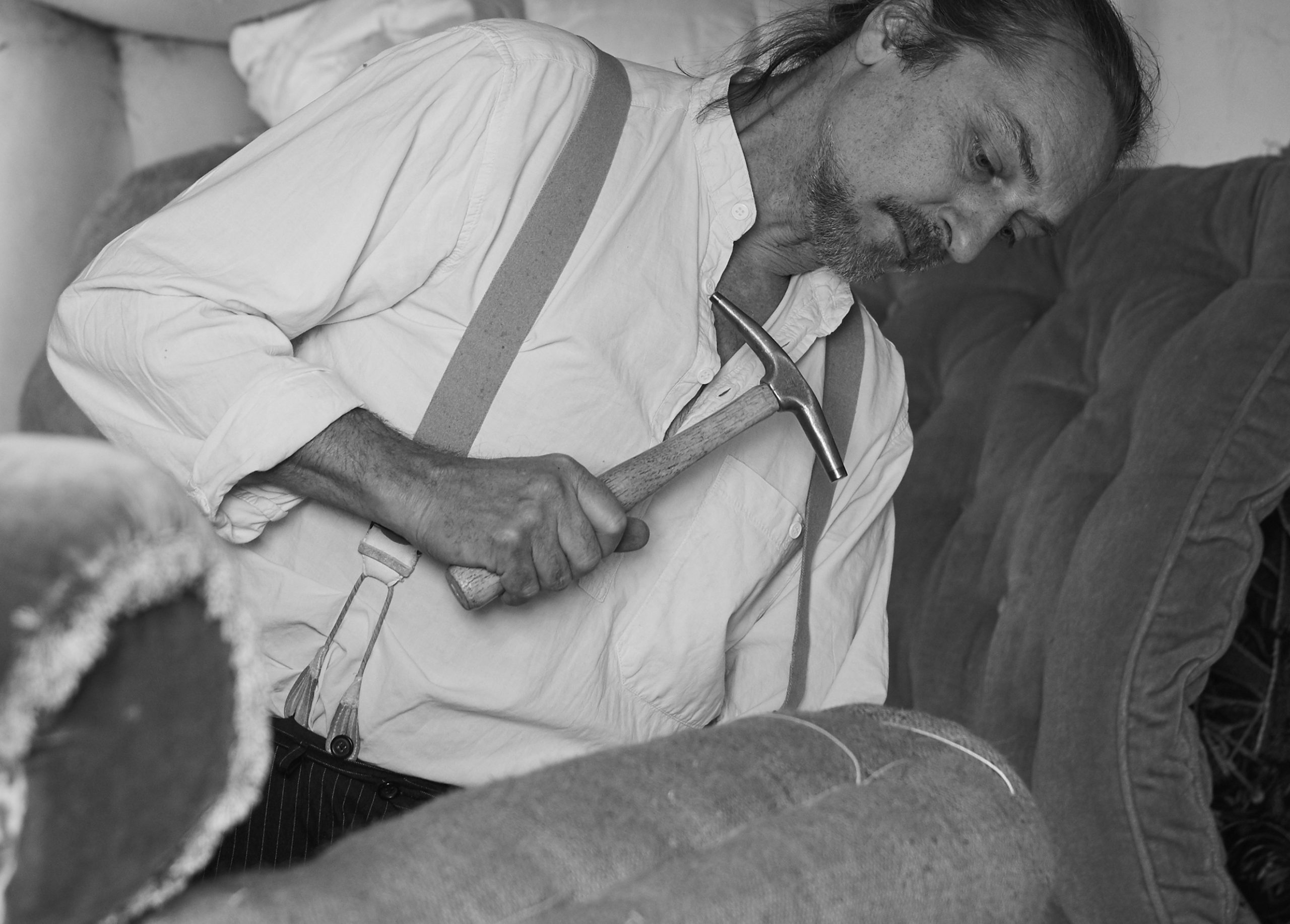 Traditional upholsterer at work